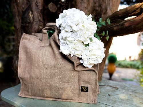 reusable canvas bag in natural colourway with white flowers