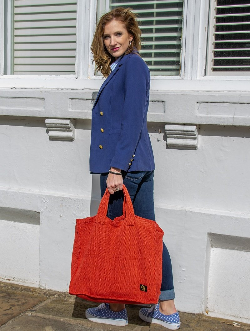 lady with a big red canvas shopper bag
