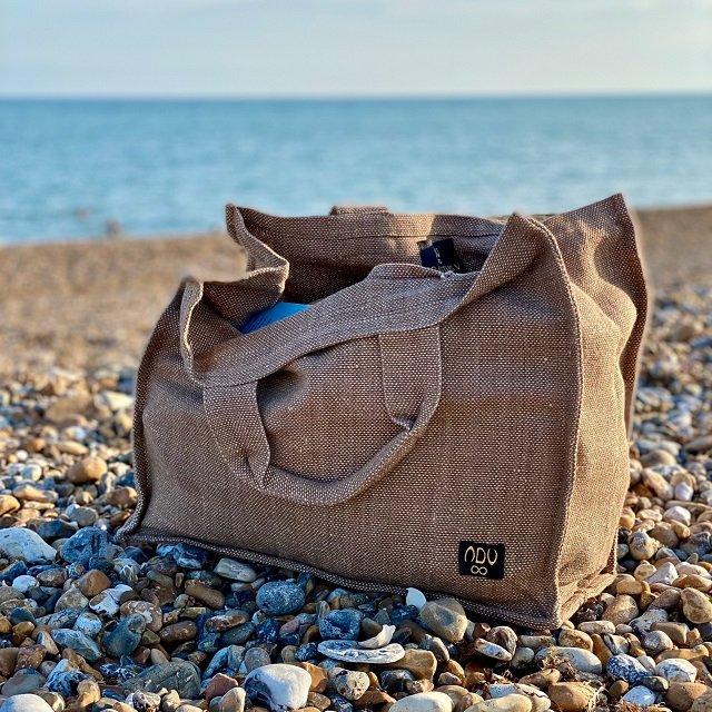 canvas shopper bag on a pebble beach