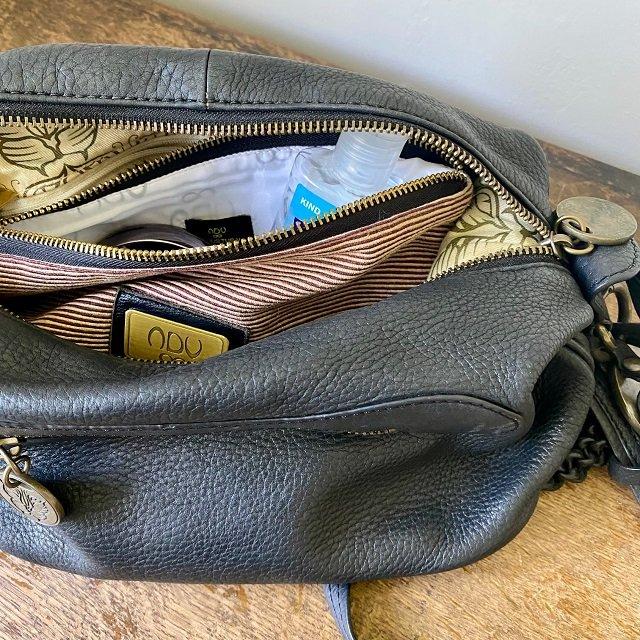 medium size brown cotton pouch bag inside a handbag