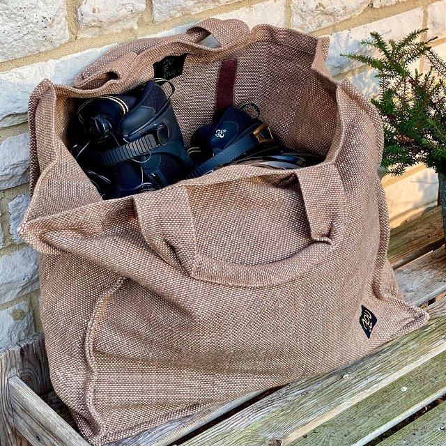 reusable canvas shopper bag with inline skates on a bench