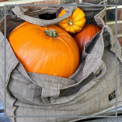 large sturdy canvas bag filled up with pumpkins
